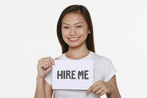 Girl Showing Hire Me Sign