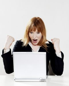 Girl Excited by Her Computer